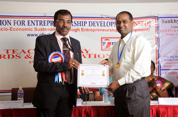 Prof.A.Suresh Kumar, HOD - MBA, Placement Officer conferred 'Young Educator and Researcher' award by NFED, Coimbatore, on 05 Sep 2014